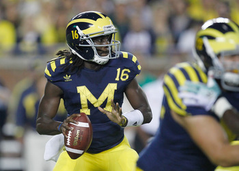 ANN ARBOR, MI - SEPTEMBER 10:  Denard Robinson #16 of the Michigan Wolverines drops back to throw a first quarter pass while playing the Notre Dame Fighting Irish at Michigan Stadium on September 10, 2010 in Ann Arbor, Michigan. (Photo by Gregory Shamus/G