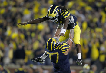 ANN ARBOR, MI - SEPTEMBER 10: Denard Robinson #16 of the Michigan Wolverines celebrates the game winning touchdown with Taylor Lewan #77 to beat the Notre Dame Fighting Irish 35-31 at Michigan Stadium on September 10, 2010 in Ann Arbor, Michigan. (Photo b