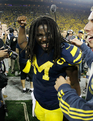 ANN ARBOR, MI - SEPTEMBER 10: Denard Robinson #16 of the Michigan Wolverines reacts after beating the Notre Dame Fighting Irish 35-31 at Michigan Stadium on September 10, 2010 in Ann Arbor, Michigan. (Photo by Gregory Shamus/Getty Images)