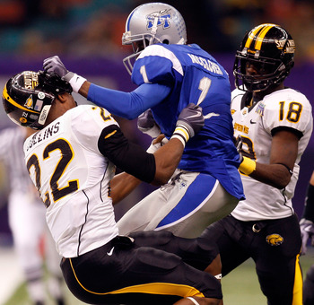 NEW ORLEANS - DECEMBER 20:  Chris McClover #1 of the Middle Tennessee Blue Raiders is tackled by Jamie Collins #22 and Eddie Hicks #18 of the Southern Miss Golden Eagles during the R+L Carriers New Orleans Bowl at the Louisiana Superdome on December 20, 2
