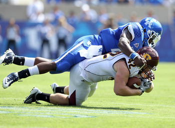 LEXINGTON, KY - SEPTEMBER 10: Tyler Lombardo #42 of the Central Michigan Chippewas is tackled by Danny Trevathan #22 of the Kentucky Wildcats during the game at Commonwealth Stadium on September 10, 2011 in Lexington, Kentucky.  (Photo by Andy Lyons/Getty