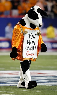 ATLANTA - DECEMBER 31:  The Chick-fil-A Cow wears a Tennessee Volunteers jersey and an 'Eat Mor Chikin' sign during the Chick-fil-A Bowl between the Tennessee Volunteers and the Virginia Tech Hokies at the Georgia Dome on December 31, 2009 in Atlanta, Geo