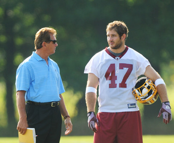 ASHBURN, VA - JULY 29:  Former football player Joe Theismann and Chris Cooley #47 of the Washington Redskins talk during the first day of training camp at Redskins Park on July 29, 2011 in Ashburn, Virginia.  (Photo by Mitchell Layton/Getty Images)