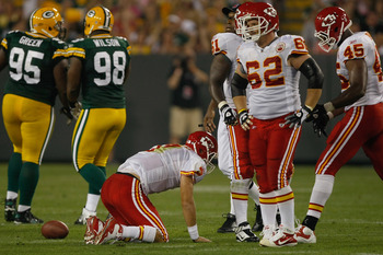 GREEN BAY, WI - SEPTEMBER 1: Matt Cassel #7 of the Kansas City Chiefs kneels on the field after being injured in the second quarter during a preseason game against the Green Bay Packers at Lambeau Field on September 1, 2011 in Green Bay, Wisconsin. (Photo