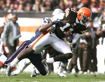 CLEVELAND - NOVEMBER 07:  Wide receiver Mohamed Massaquoi #11 of the Cleveland Browns is hit by safety James Sanders #36 of the New England Patriots at Cleveland Browns Stadium on November 7, 2010 in Cleveland, Ohio.  (Photo by Matt Sullivan/Getty Images)