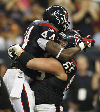 HOUSTON - AUGUST 20:  Running back Ben Tate #44 of the Houston Texans celebrates with guard Mike Brisiel #65 after scoring on a four yard run in the second quarter against the New Orleans Saints at Reliant Stadium on August 20, 2011 in Houston, Texas.  (P