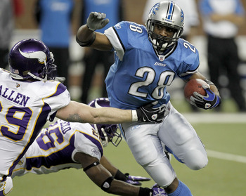 DETROIT, MI - JANUARY 02: Maurice Morris #28 of the Detroit Lions tries to get around the tackle of Jared Allen #69 of the Minnesota Vikings at Ford Field on January 2, 2011 in Detroit, Michigan. Detroit won the game 20-13.  (Photo by Gregory Shamus/Getty