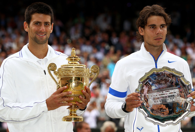 LONDON, ENGLAND - JULY 03:  Winner Novak Djokovic of Serbia (L) and runner-up Rafael Nadal of Spain with their trophies after their final round Gentlemen's match on Day Thirteen of the Wimbledon Lawn Tennis Championships at the All England Lawn Tennis and