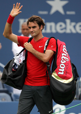 NEW YORK, NY - SEPTEMBER 10:  Roger Federer of Switzerland walks off the court after he lost to Novak Djokovic of Serbia during Day Thirteen of the 2011 US Open at the USTA Billie Jean King National Tennis Center on September 10, 2011 in the Flushing neig
