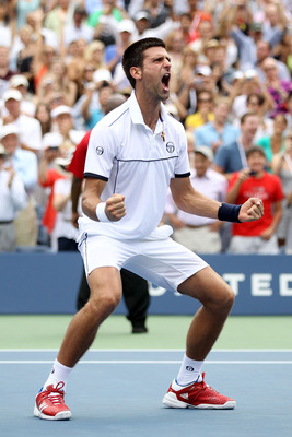NEW YORK, NY - SEPTEMBER 10:  Novak Djokovic of Serbia reacts after he won his match against Roger Federer of Switzerland during Day Thirteen of the 2011 US Open at the USTA Billie Jean King National Tennis Center on September 10, 2011 in the Flushing nei