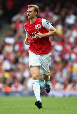 Germany international Per Mertesacker will strengthen Arsenal's defence.