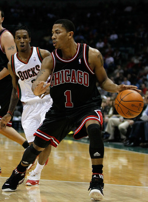 MILWAUKEE - NOVEMBER 30: Derrick Rose #1 of the Chicago Bulls moves past Brandon Jennings #3 of the Milwaukee Bucks at the Bradley Center on November 30, 2009 in Milwaukee, Wisconsin. NOTE TO USER: User expressly acknowledges and agrees that, by downloadi