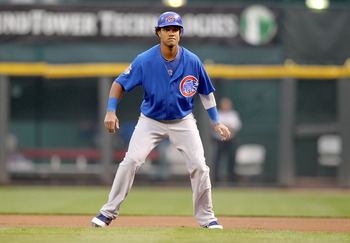 CINCINNATI, OH - SEPTEMBER 14:  Starlin Castro #13 of the Chicago Cubs leads off of first base during the game against the Cincinnati Reds at Great American Ball Park on September 14, 2011 in Cincinnati, Ohio.  (Photo by Andy Lyons/Getty Images)