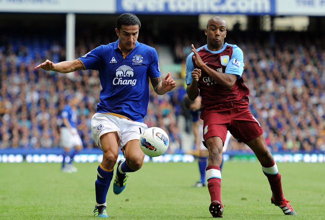 LIVERPOOL, ENGLAND - SEPTEMBER 10:  Tim Cahill of Everton competes with Fabian Delph of Aston Villa during the Barclays Premier League match between Everton and Aston Villa at Goodison Park on September 10, 2011 in Liverpool, England.  (Photo by Chris Bru
