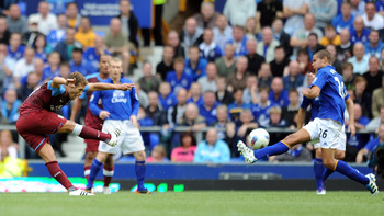 LIVERPOOL, ENGLAND - SEPTEMBER 10:  Stiliyan Petrov of Aston Villa scores his side's first goal during the Barclays Premier League match between Everton and Aston Villa at Goodison Park on September 10, 2011 in Liverpool, England.  (Photo by Chris Brunski