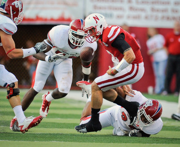 LINCOLN, NE - SEPTEMBER 10: Taylor Martinez #3 of the Nebraska Cornhuskers has the ball knocked loose by Malique Micenheimer #22 of the Fresno State Bulldogs during their game at Memorial Stadium September 10, 2011 in Lincoln, Nebraska. (Photo by Eric Fra
