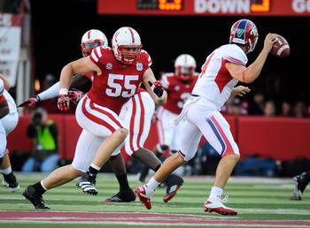 LINCOLN, NE - SEPTEMBER 10: Baker Steinkuhler #55 of the Nebraska Cornhuskers chases Derek Carr #4 of the Fresno State Bulldogs during their game at Memorial Stadium September 10, 2011 in Lincoln, Nebraska.  (Photo by Eric Francis/Getty Images)