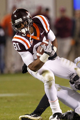 BLACKSBURG, VA - NOVEMBER 04: Wide receiver Jarrett Boykin #81 of the Virginia Tech Hokies is tackled while running with the ball against the Georgia Tech Yellow Jackets at Lane Stadium on November 4, 2010 in Blacksburg, Virginia.  (Photo by Geoff Burke/G