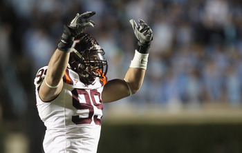CHAPEL HILL, NC - NOVEMBER 13:  James Gayle #99 of the Virginia Tech Hokies celebrates after a sack against the North Carolina Tar Heels during their game at Kenan Stadium on November 13, 2010 in Chapel Hill, North Carolina.  (Photo by Streeter Lecka/Gett