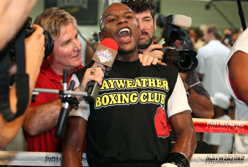 LAS VEGAS, NV - SEPTEMBER 06:  Floyd Mayweather has a few comments for a member of the media during his workout training session at his gym on September 6, 2011 in Las Vegas, Nevada.  (Photo by Jeff Bottari/Getty Images)
