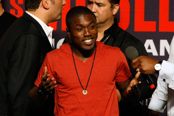 LAS VEGAS - APRIL 30:  Boxer Andre Berto reacts to the crowd from the stage before the start of the Floyd Mayweather Jr. and Shane Mosley weigh-in at the MGM Grand Garden Arena on April 30, 2010 in Las Vegas, Nevada. Mayweather and Mosley will meet in a 1