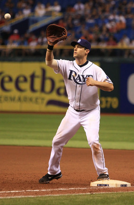 ST. PETERSBURG, FL - SEPTEMBER 10: Casey Kotchman #11 of the Tampa Bay Rays catches the ball at first for an out against the Boston Red Sox during the game on September 10, 2011 at Tropicana Field in St. Petersburg, Florida. (Photo by Steven Kovich/Getty