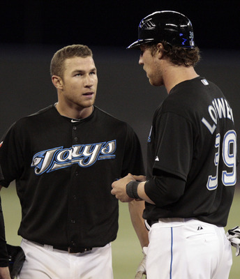 TORONTO, CANADA - SEPTEMBER 7: Adam Loewen #39 talks with Brett Lawrie #13 of the Toronto Blue Jays during MLB action against the Boston Red Sox at the Rogers Centre September 7, 2011 in Toronto, Ontario, Canada. (Photo by Abelimages/Getty Images)