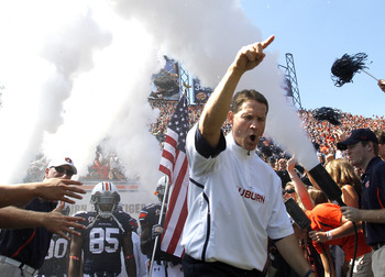 AUBURN, AL - SEPTEMBER 10:  Coach Gene Chizik of the Auburn Tigers leads the team onto the field to start the game against the Mississippi State Bulldogs on September 10, 2011 at Jordan-Hare Stadium in Auburn, Alabama. (Photo by Butch Dill/Getty Images)