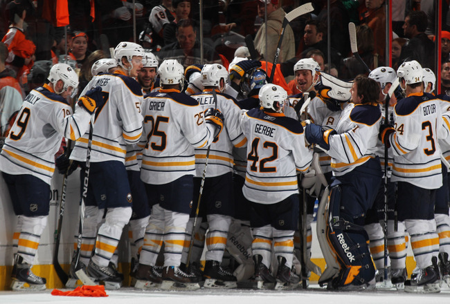 PHILADELPHIA, PA - APRIL 22:  Tyler Ennis #63 of the Buffalo Sabres celebrates with teammates after scoring the game winning goal in overtime in Game Five of the Eastern Conference Quarterfinals during the 2011 NHL Stanley Cup Playoffs at Wells Fargo Cent
