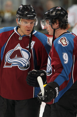 DENVER - NOVEMBER 09:  Paul Stastny #26 and Matt Duchene #9 of the Colorado Avalanche talk during warm ups prior to facing the Calgary Flames at Pepsi Center on November 9, 2010 in Denver, Colorado.  (Photo by Doug Pensinger/Getty Images)
