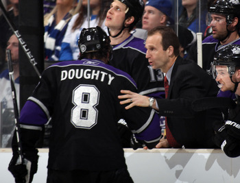 LOS ANGELES, CA - JANUARY 10: Assistant coach Jamie Kompon gives last minute instructions to Drew Doughty #8 of the Los Angeles Kings in their game against the Toronto Maple Leafs at the Staples Center on January 10, 2011 in Los Angeles, California. The L