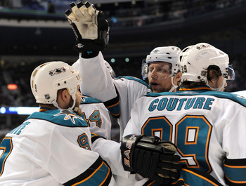 VANCOUVER, CANADA - MAY 18:  Dany Heatley #15 of the San Jose Sharks celebrates with teammates Ian White #9, Marc-Edouard Vlasic #44 and Logan Couture #39 after Couture scored a power play goal against the Vancouver Canucks in the first period in Game Two