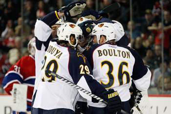 MONTREAL, CANADA - MARCH 29:  Members of the Atlanta Thrashers celebrate the third-period goal from teammate Nik Antropov #80 during the NHL game against the Montreal Canadiens at the Bell Centre on March 29, 2011 in Montreal, Quebec, Canada.  The Canadie