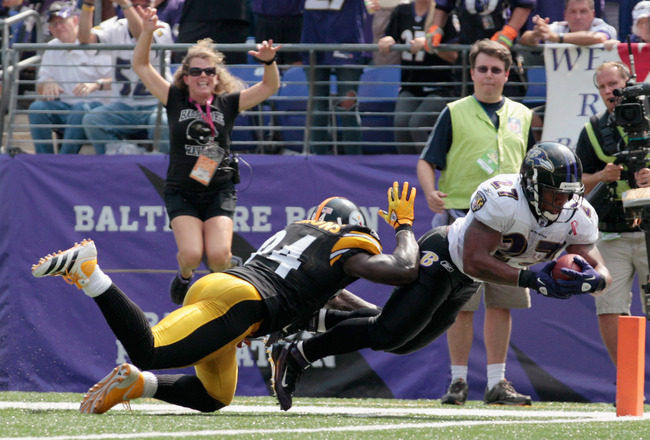 BALTIMORE, MD - SEPTEMBER 11: Running back  Ray Rice #27 of the Baltimore Ravens dives into the end zone for a touchdown as defender  Lawrence Timmons #94 of the Pittsburgh Steelers tries to stop him during the first half of the season opener at M&T Bank