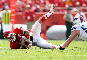 KANSAS CITY, MO - SEPTEMBER 11:  Quarterback Matt Cassel #7 of the Kansas City Chiefs is sacked by Kyle Williams #95 of the Buffalo Bills during the game at Arrowhead Stadium on September 11, 2011 in Kansas City, Missouri.  (Photo by Jamie Squire/Getty Im