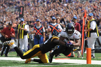 BALTIMORE - SEPTEMBER 11:  Ray Rice #27 of the Baltimore Ravens scores a touchdown against the Pittsburgh Steelers during the season opener at M&T Bank Stadium on September 11. 2011 in Baltimore, Maryland. The Ravens lead the Steelers 21-7 at the half. (P