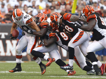 CLEVELAND, OH - SEPTEMBER 11:  Running back Peyton Hillis #40 of the Cleveland Browns is tackled by defensive players of the Cincinnati Bengals during the season opener  at Cleveland Browns Stadium on September 11, 2011 in Cleveland, Ohio.  (Photo by Matt