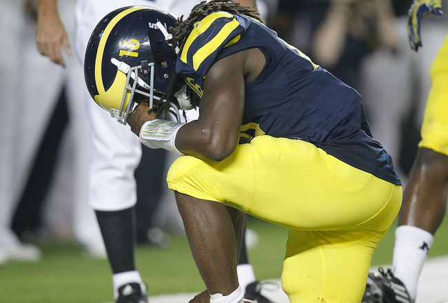 ANN ARBOR, MI - SEPTEMBER 10: Denard Robinson #16 of the Michigan Wolverines reacts after scoring a fourth quarter touchdown while playing the Notre Dame Fighting Irish at Michigan Stadium on September 10, 2010 in Ann Arbor, Michigan. Michigan won the gam