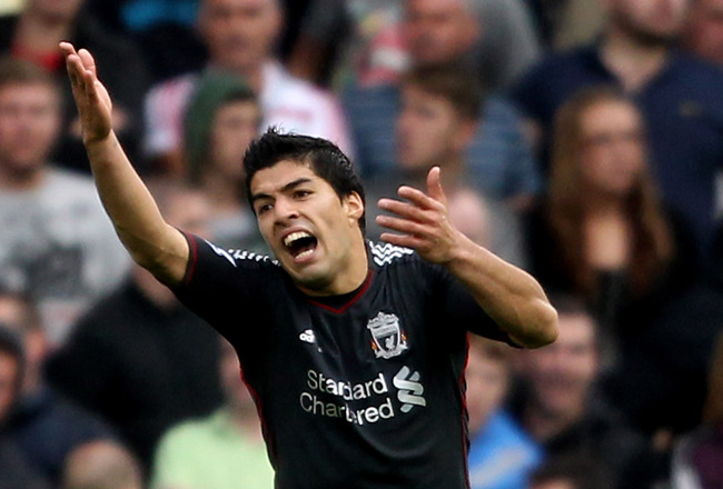 STOKE ON TRENT, ENGLAND - SEPTEMBER 10:  Luis Suarez of Liverpool reacts after being booked during the Barclays Premier League match between Stoke City and Liverpool at Britannia Stadium on September 10, 2011 in Stoke on Trent, England.  (Photo by Scott H