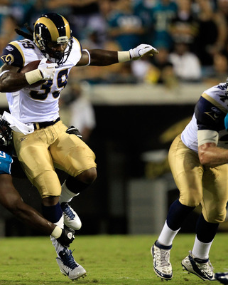 JACKSONVILLE, FL - SEPTEMBER 01:  Leger Douzable #69 of the Jacksonville Jaguars attempts to tackle Steven Jackson #39 of the St. Louis Rams during a game at EverBank Field on September 1, 2011 in Jacksonville, Florida.  (Photo by Sam Greenwood/Getty Imag