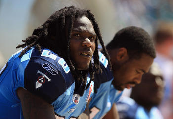 JACKSONVILLE, FL - SEPTEMBER 11:  Chris Johnson #28 of the Tennessee Titans watches on from the sidelines against the Jacksonville Jaguars during their season opener at EverBank Field on September 11, 2011 in Jacksonville, Florida.  (Photo by Streeter Lec