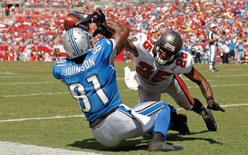 TAMPA, FL - SEPTEMBER 11:  Calvin Johnson #81 of the Detroit Lions makes a touchdown catch over  Aqib Talib #25 of the Tampa Bay Buccaneers during the season opener at Raymond James Stadium on September 11, 2011 in Tampa, Florida.  (Photo by Mike Ehrmann/