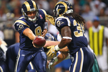 ST. LOUIS - SEPTEMBER 11: Sam Bradford #8 of the St. Louis Rams hands the ball off against the Philadelphia Eagles at the Edward Jones Dome on September 11, 2011 in St. Louis, Missouri. The Eagles beat the Rams 31-13. (Photo by Dilip Vishwanat/Getty Image
