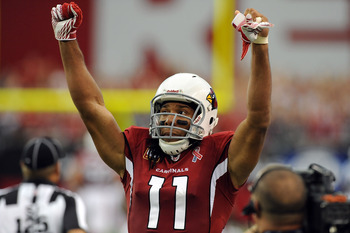GLENDALE, AZ - SEPTEMBER 11:  Larry Fitzgerald #11 of the Arizona Cardinals celebrates a 28-21 victory against the Carolina Panthers in the NFL season opening game at the University of Phoenix Stadium on September 11, 2011 in Glendale, Arizona.  (Photo by