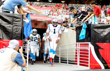 GLENDALE, AZ - SEPTEMBER 11: Quarterback Cam Newton #1 of the Carolina Panthers runs out on the field prior to the NFL season opening game against the Arizona Cardinals at the University of Phoenix Stadium on September 11, 2011 in Glendale, Arizona. (Phot