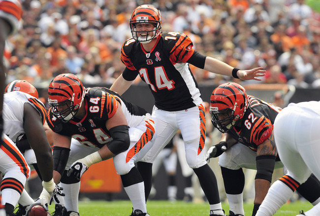 CLEVELAND, OH - SEPTEMBER 11: Starting quarterback Andy Dalton #14 of the Cincinnati Bengals calls a play from the line of scrimmage during the first quarter against the Cleveland Browns in the season opener at Cleveland Browns Stadium on September 11, 20