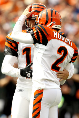 CINCINNATI - SEPTEMBER 19:  Holder Kevin Huber #10 of the Cincinatti Bengals congratulates Mike Nugent #2 after his field goal against the Baltimore ravens at Paul Brown Stadium on September 19, 2010 in Cincinnati, Ohio. (Photo by Matthew Stockman/Getty I