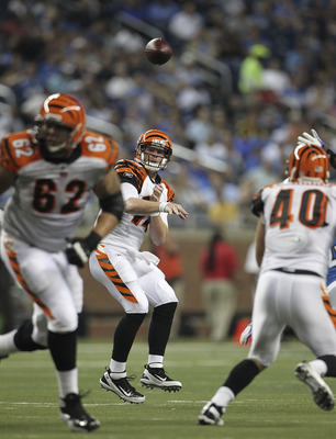 DETROIT - AUGUST 12: Andy Dalton #14 of the Cincinnati Bengals drops back to pass during the second quarter of the game against the Detroit Lions at Ford Field on August 12, 2011 in Detroit, Michigan.  (Photo by Leon Halip/Getty Images)