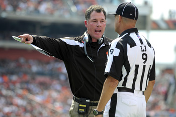 CLEVELAND, OH - SEPTEMBER 11: Head coach Pat Shurmur of the Cleveland Browns talks with Line Judge Mark Periman during the first quarter against the Cincinnati Bengals in the season opener at Cleveland Browns Stadium on September 11, 2011 in Cleveland, Oh