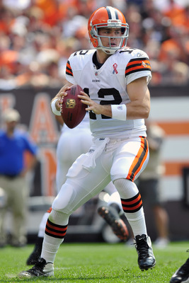 CLEVELAND, OH - SEPTEMBER 11: Starting quarterback Colt McCoy #12 of the Cleveland Browns looks down field for a pass during the first quarter against the Cincinnati Bengals in the season opener at Cleveland Browns Stadium on September 11, 2011 in Clevela